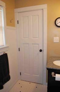 Purchased at an architectural outlet store, this bathroom door completes the clean, simple look and design of this master bathroom.