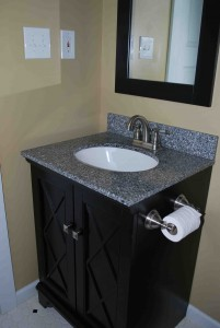 This bathroom vanity...bought on clearance...adds to the country-cottage look of this small master bath.