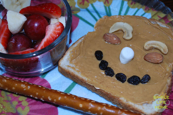 Funny face with fruit and pretzel